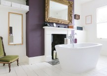 Exquisite eclectic bathroom with a purple accent wall