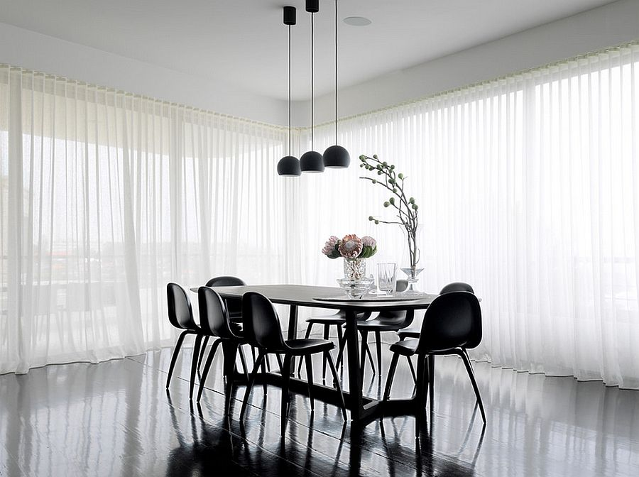 Fascinating dining room design dips into the beauty of black [Design: Luigi Rosselli Architects]