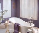 Feminine bathroom idea with a splash of purple [Design: Lisa Scheff Designs]