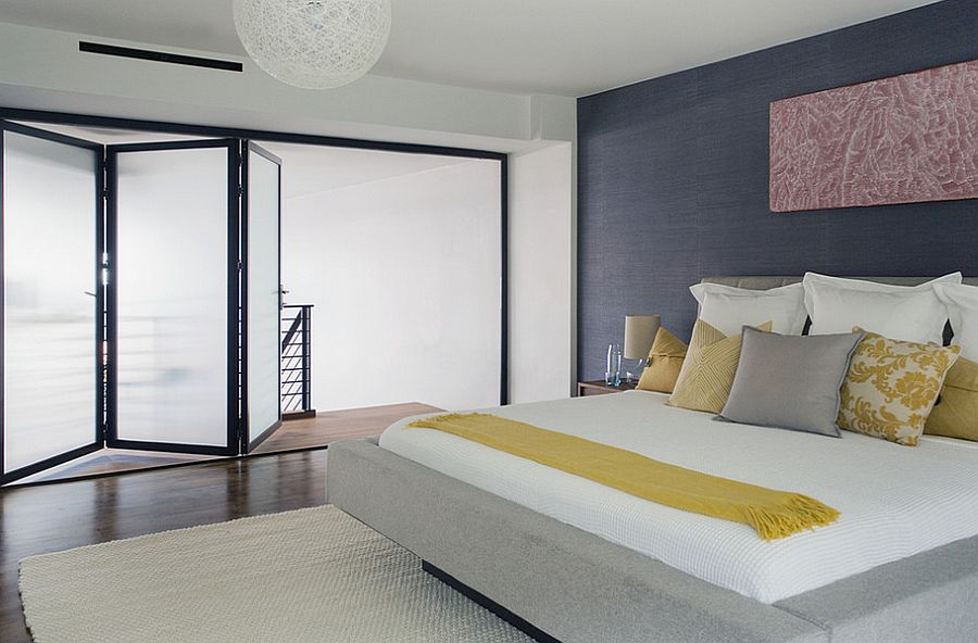 Flexible partition seperates the bedroom from the staircase landing