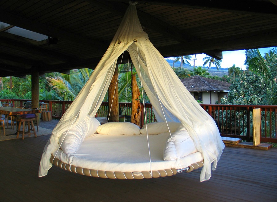 A floating bed on a Maui deck