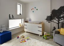 Framed windows and a cool color scheme shape the trendy nursery