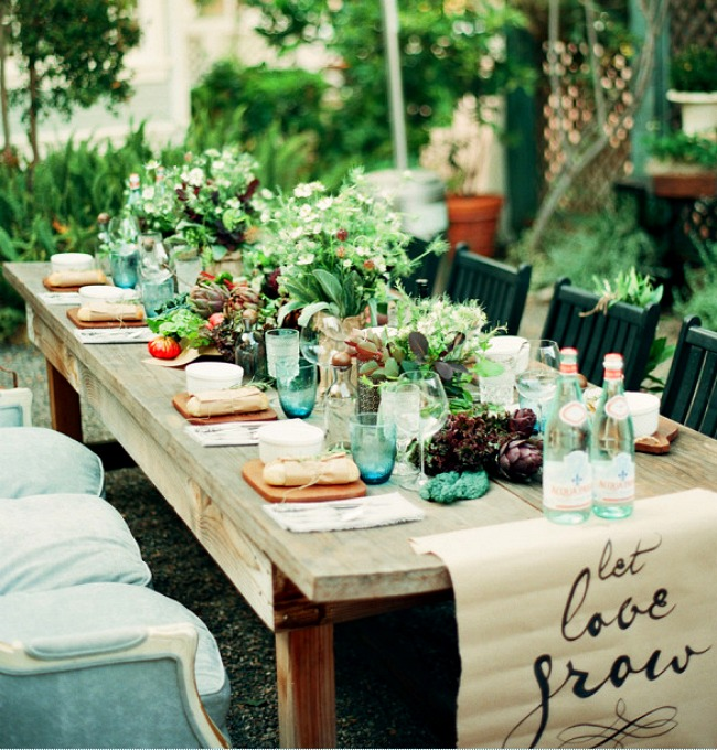 Instead of extra chairs, a sofa provides seating on one side  Green and Gorgeous Garden-Inspired Table Settings Garden Table Too