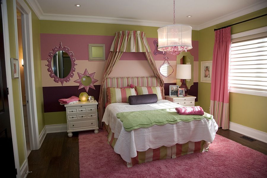 Girls' bedroom with a striped accent wall [Design: Jennifer Brouwer Design Inc]