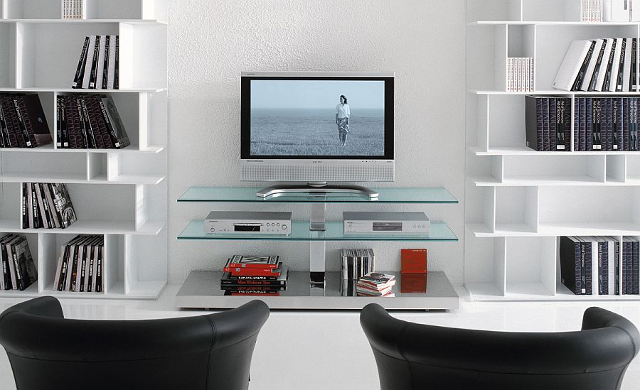 Gorgeous TV unit with glass shleves flanked by bookshelves