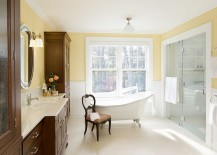 Gorgeous bathroom uses yellow in a charming, traditional fashion