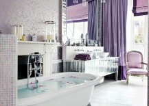 Gorgeous bathroom with purple glam dips into the magic of luxe wallpaper!