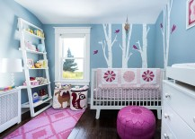 Gorgeous blue nursery with a woodsy theme and a touch of pink
