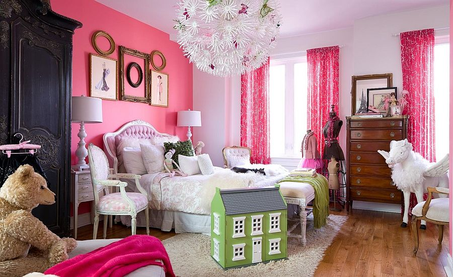 Gorgeous girls' bedroom with pink accent wall [Photography: Brandon Barré]