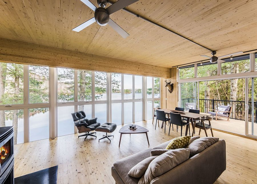 Gorgeous living area enclosed in glass panels overlooking the lake