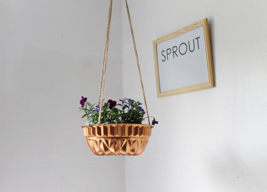 Hanging bundt pan planter from Etsy shop Boots N Gus