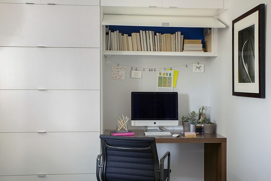 Home office with ample shelf space and small workstation