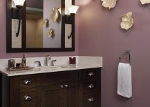 Interesting use of wall art in the purple contemporary bathroom