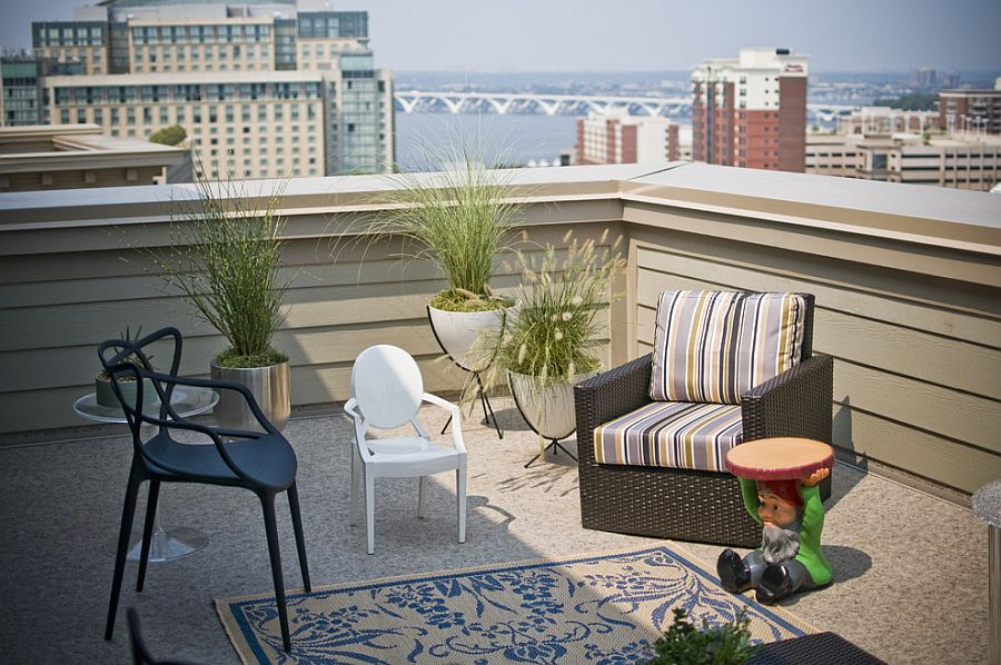Kartell masterpieces meet the iconic Bullet Planter on a relaxed deck [Design: Patrick J. Baglino, Jr. Interior Design]