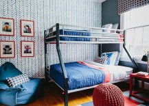 Kids' bedroom with chevron pattern accent wallpaper and bunk bed