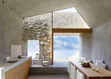 Kitchen and dining area of the Swiss house overlooking the lake 217x155 Historic Stone House in Switzerland Gets a Modern Minimalist Facelift