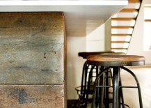 Kitchen island with wood panel covering and stools with an industrial touch