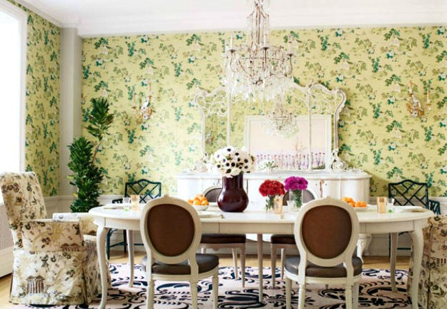 Here a large dining room wall gets color and pattern from wallpaper