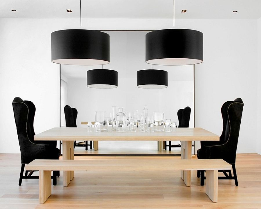Large black drum pendants add drama to the chic dining room [Design: Nicole Hollis / Ben Mayorga Photography]