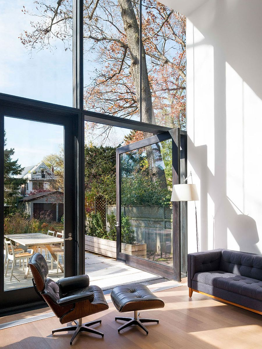 Large framed glass doors connect the interior with the backyard