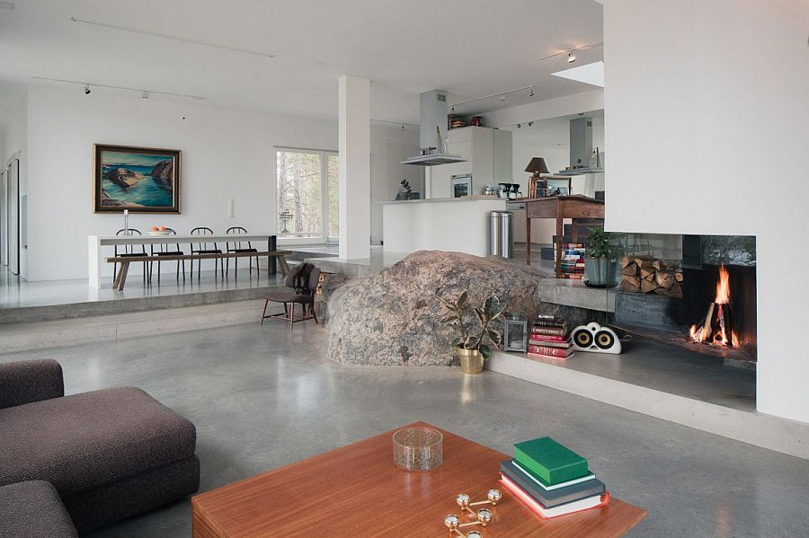Large natural rock in the middle of the contemporary living area