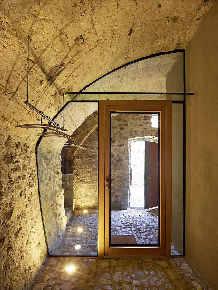Lighting brings cozy warmth to the renovated stone house