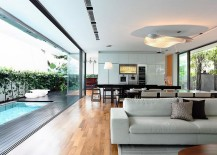 Living area of the lovely Singapore home connected with the deck space outside