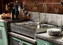Lovely metal backsplash and brick walls in the vintage kitchen