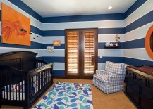 Lovely use of stripes and pops of orange in the cool nursery