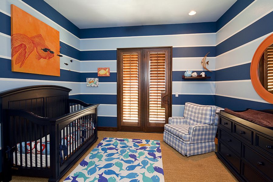 Lovely use of stripes and pops of orange in the cool nursery [Design: Bravo Interior Design]
