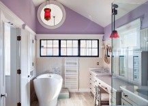 Luxurious purple bathroom with custom windows and beadboard accents
