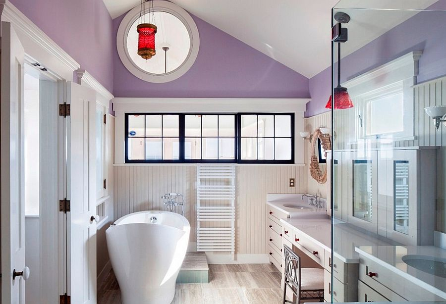 Luxurious purple bathroom with custom windows and beadboard accents [Design: Cape Associates]