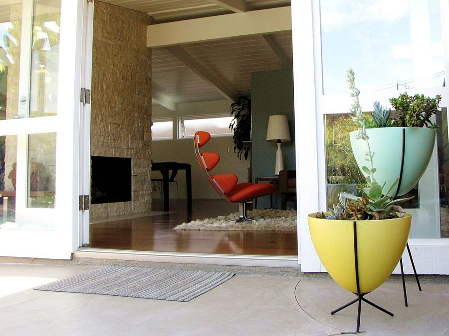 Midcentury entry with bullet planters in yellow and light blue [From: Tara Bussema - Neat Organization and Design]