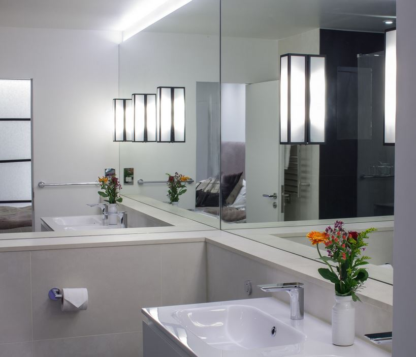Minimalist bathroom with mirrored walls