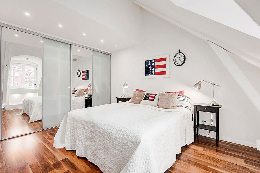 Mirrored and partitions visually enlarge the space in the bedroom