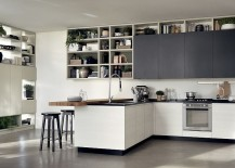 Multiple open and closed shelves give the kitchen plenty of storage space