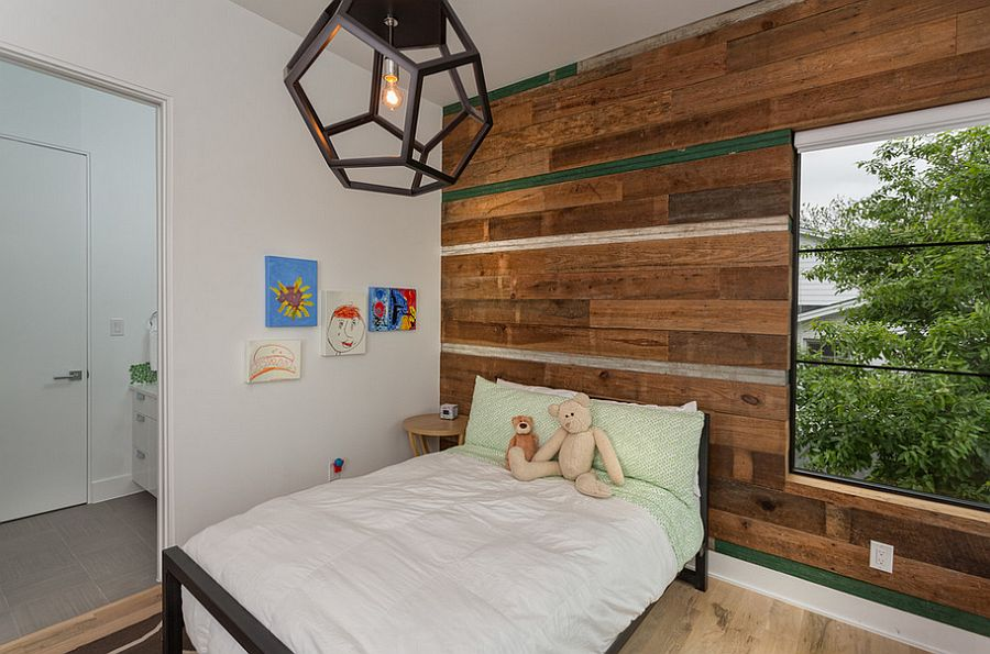Natural materials help shape a relaxed ambiance inside the kids' room [Design: Cornerstone Architects]