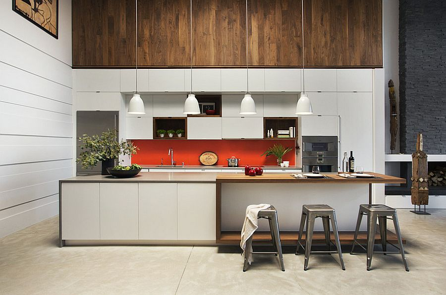 Orange adds a hint of excitement to the trendy kitchen