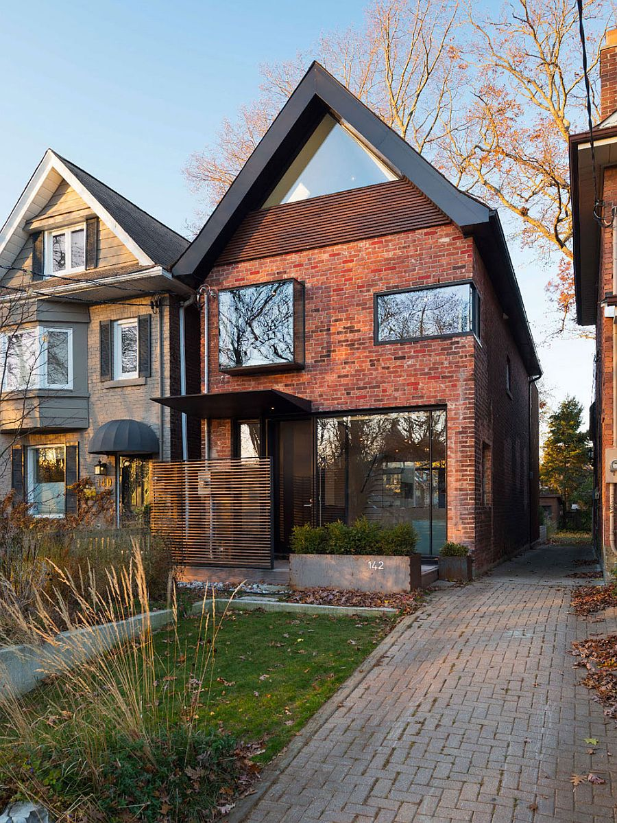 Early 1900s toronto home with a glassy modern renovation for Classic house facades