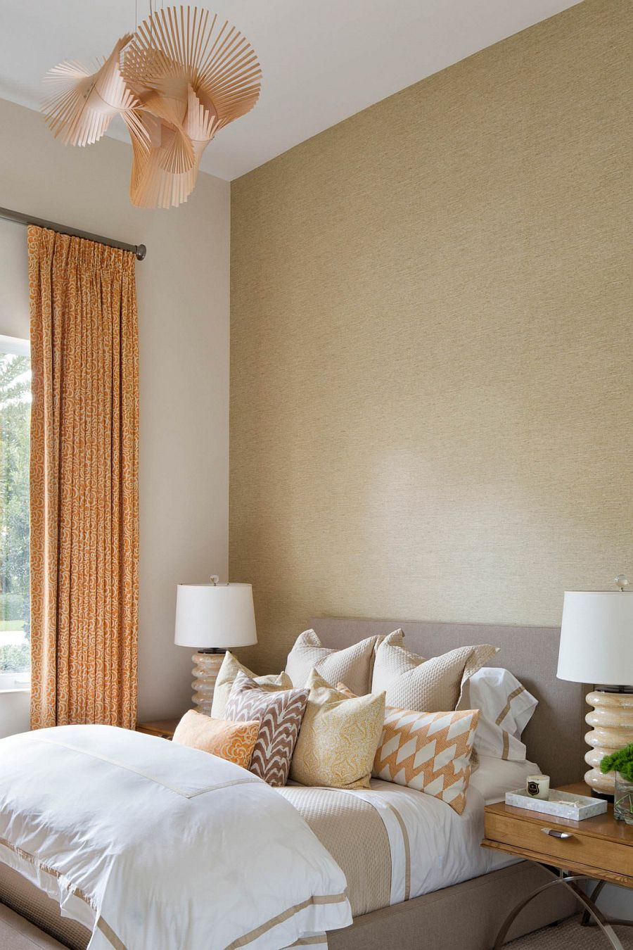 Pops of coral bring elegant charm to the calming bedroom