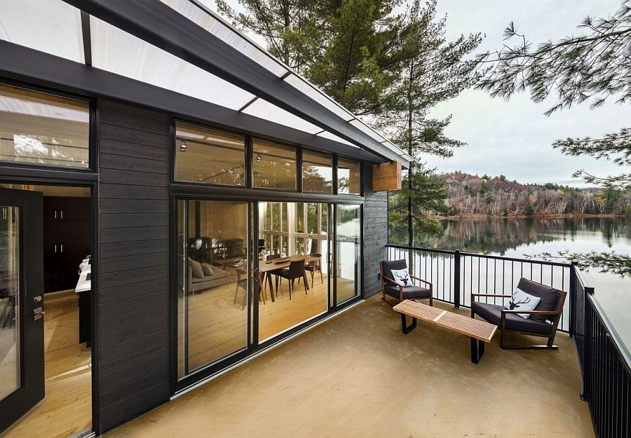 Private deck of the cottage overlooking the tranquil lake