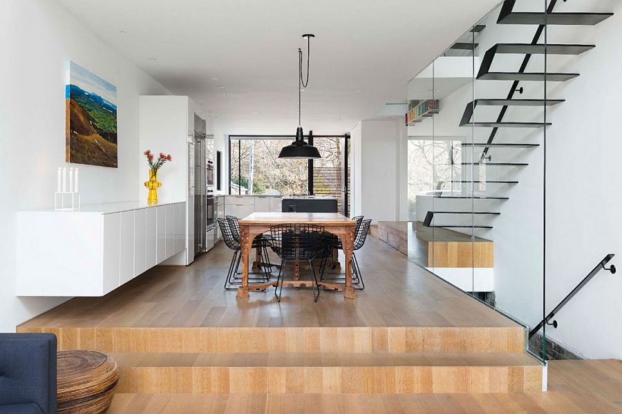 Raised wooden platform seperates the dining and kitchen areas from the entry