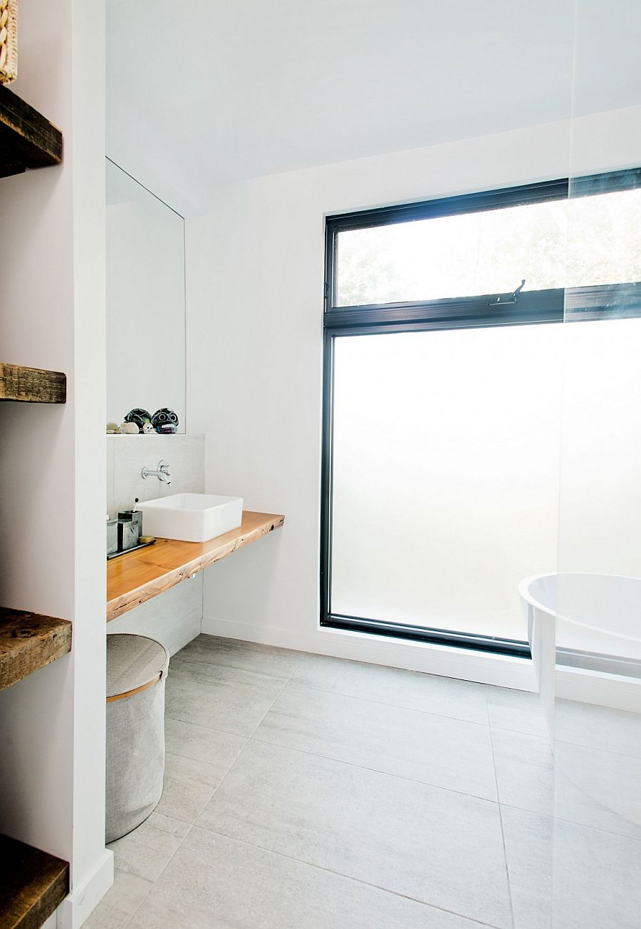 Reclaimed wood used to shape shelves in the bathroom
