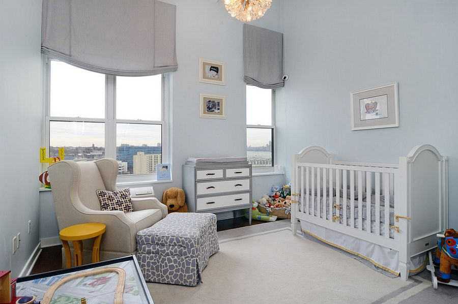 Simple light blue backdrop gives the nursery a tranquil look [Design: Hudson Place Realty]