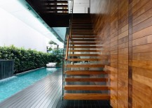 Sleek-floating-staircase-connects-the-private-deck-with-the-master-bedroom-above-217x155