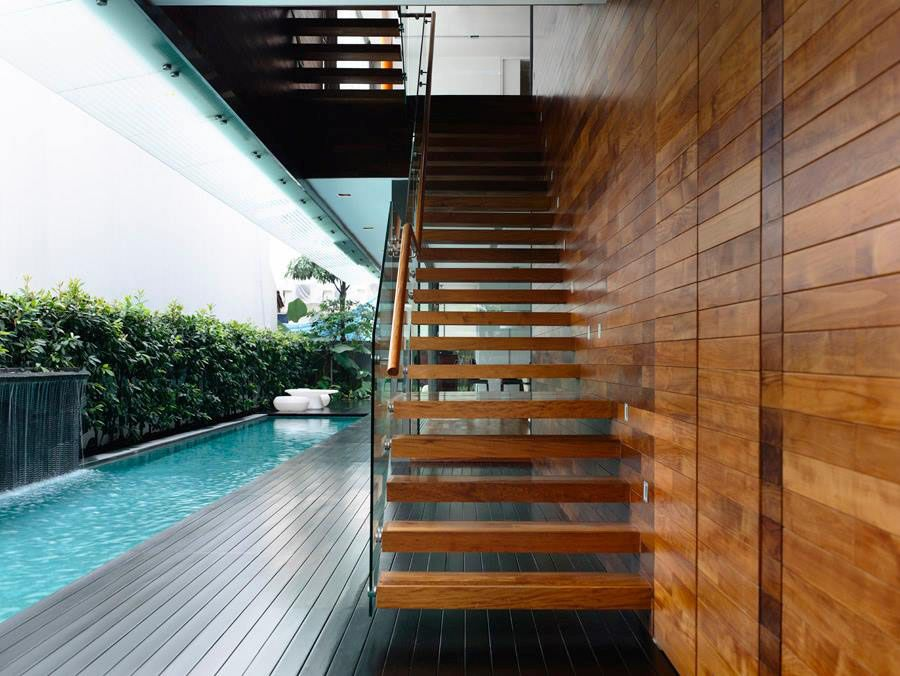Sleek floating staircase connects the private deck with the master bedroom above