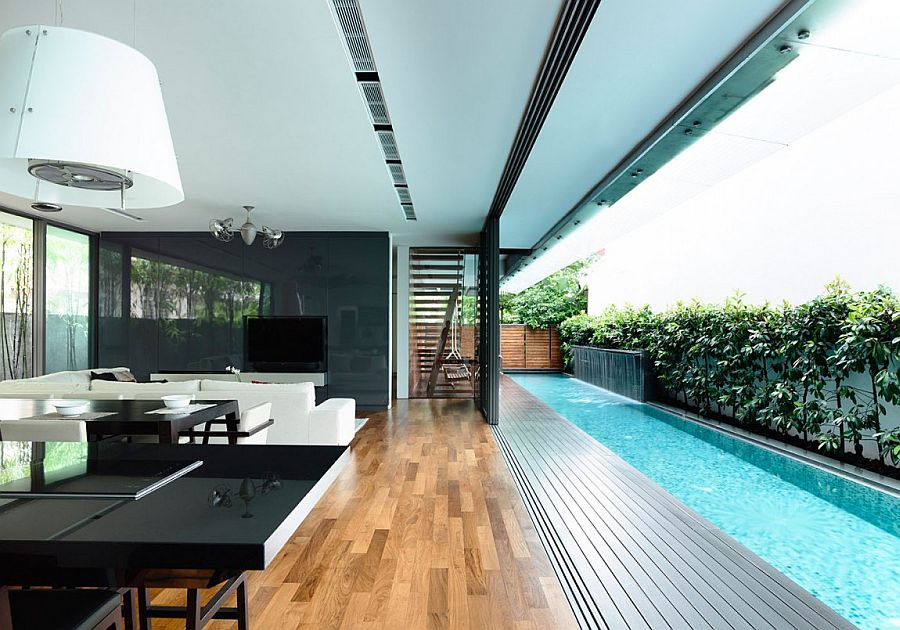 Sliding glass doors connect the interior with the courtyard and lap pool outside