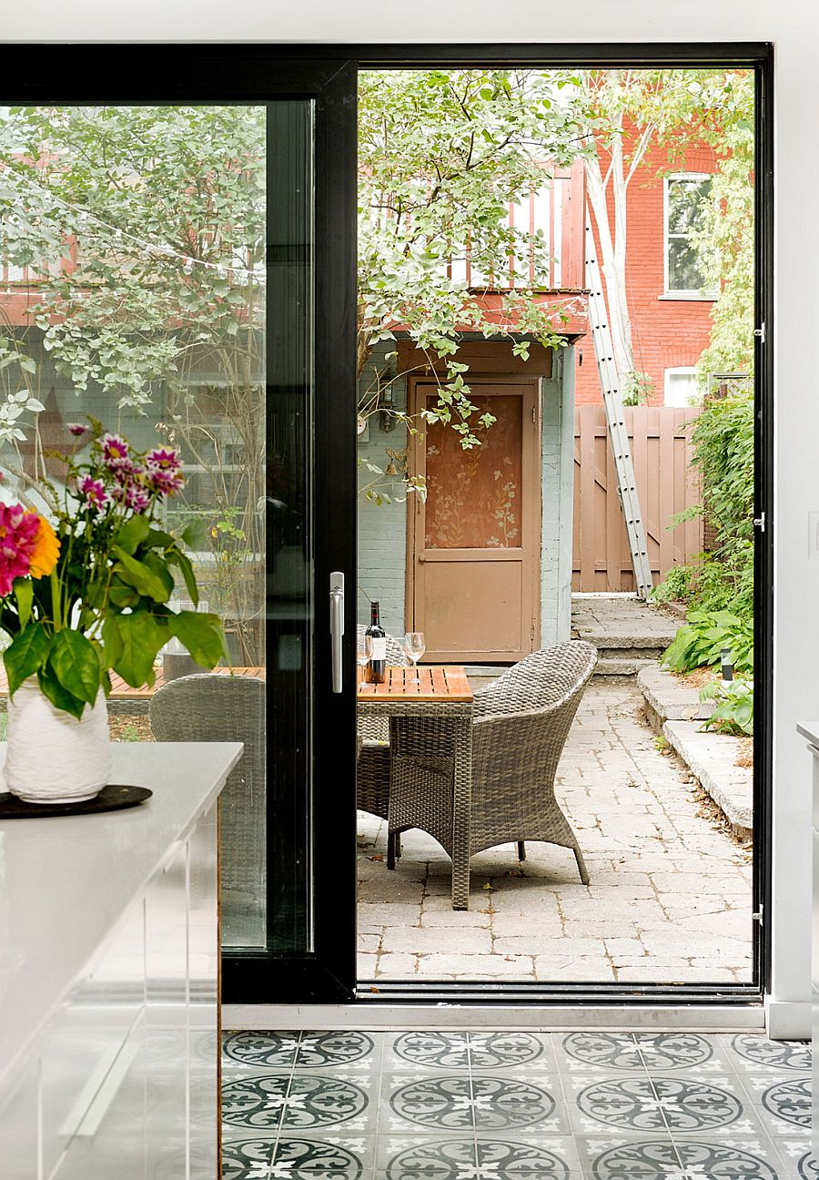 Sliding glass doors connect the kitchen with the backyard