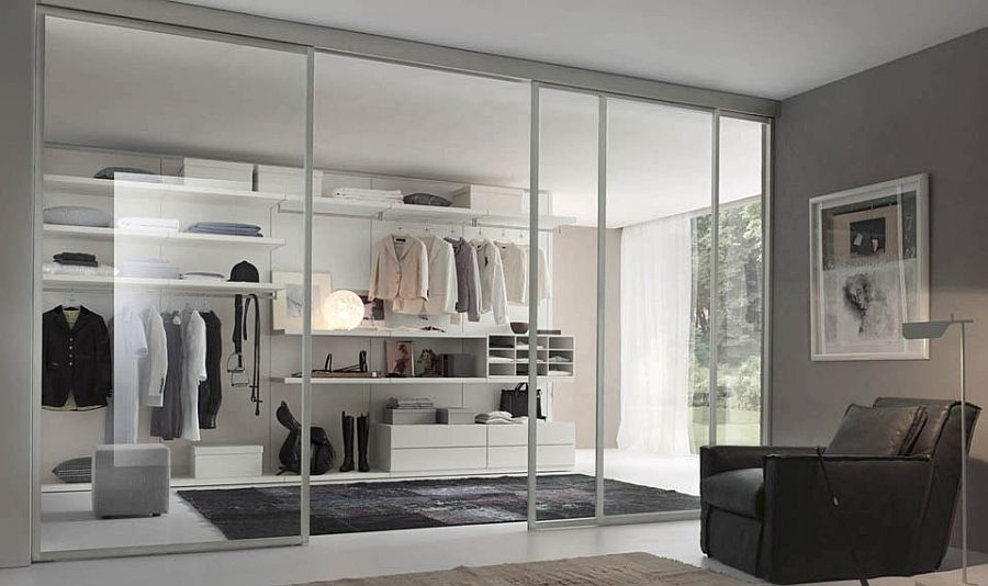 Sliding glass doors visually connect the closet with the bedroom