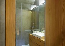 Small bathroom with wooden vanity and shower area